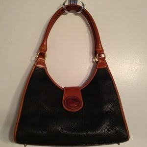 Vintage Dooney and Bourke all-weather leather bag.